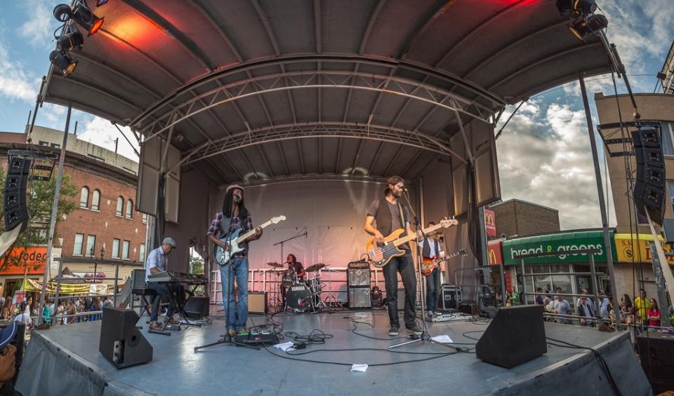 Live concert musicians on street stage