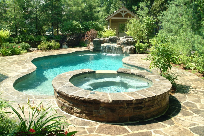 Gib San Freeform pool with integrated spa