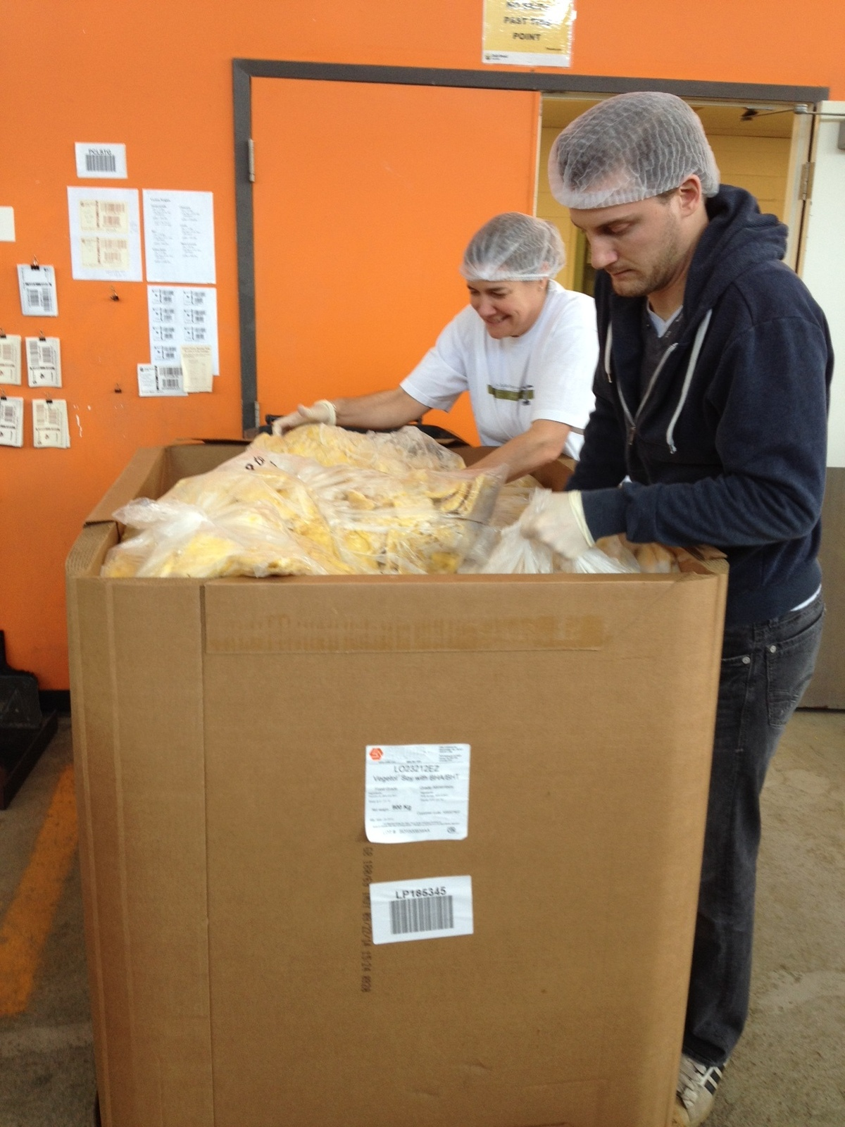 Volunteering at the Daily Bread Food Bank - Julie and Tyler